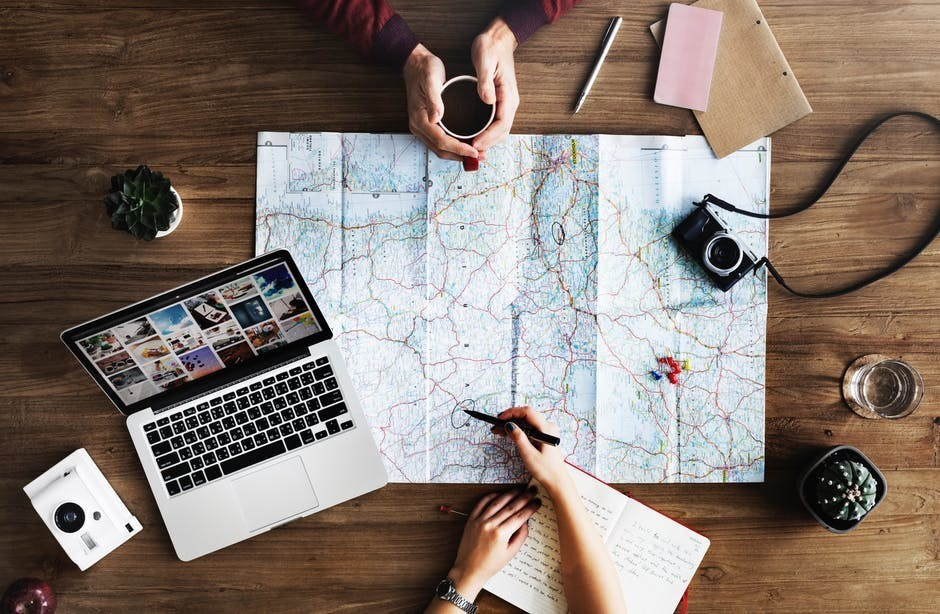 Travel planning and blogging using maps and laptops